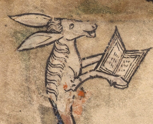 Medieval manuscript illustration of a donkey laughing and holding a book with its front hooves.