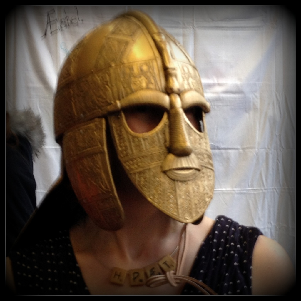 Woman wearing a replica of the Sutton Hoo helmet.