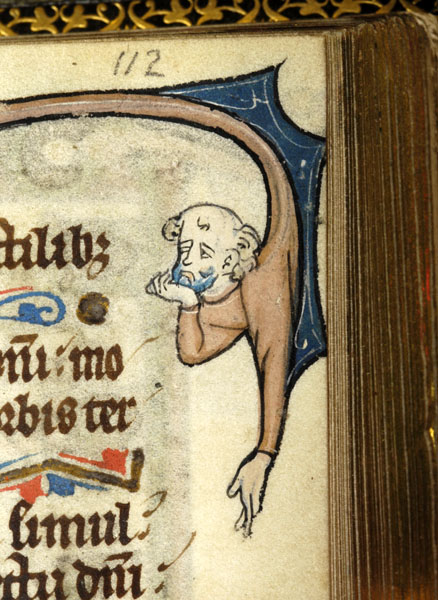 Medieval manuscript image of bald man's head and arms extending down from part of a large initial, his right hand raised to his chin and his left hanging below him.