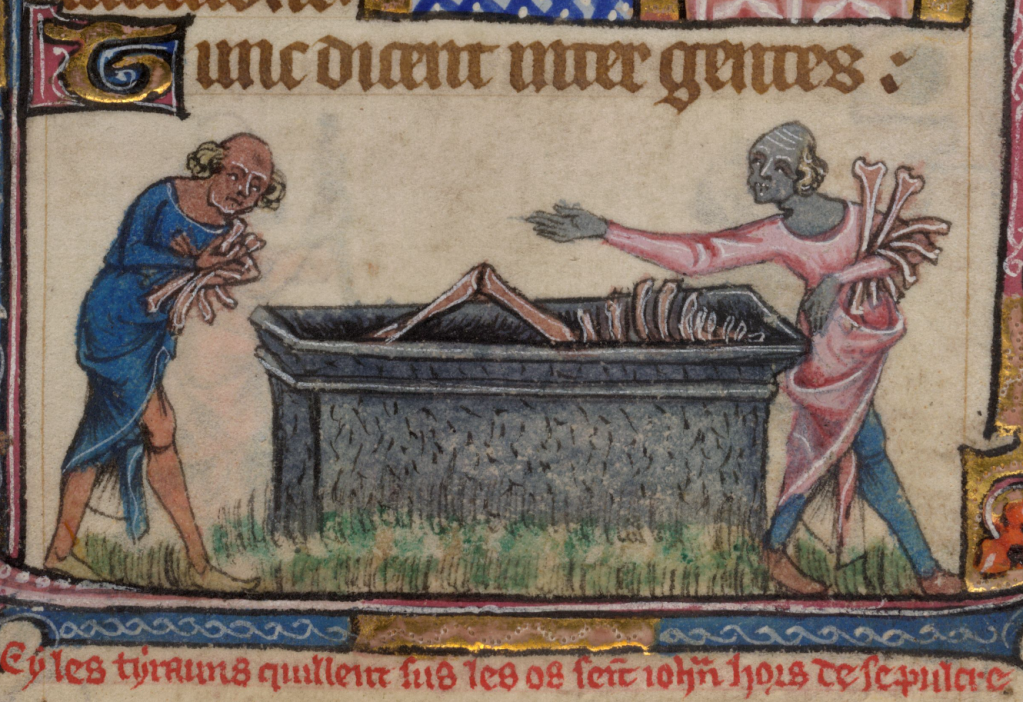 Medieval manuscript illustrations of two people (one of whom is grey like a corpse) stealing bones from an open tomb containing a partially visible skeleton; a Latin inscription in red ink below the image identifies it as the tomb of John the Baptist.
